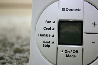 USED RV DOMETIC 3313197.000 LCD SINGLE ZONE THERMOSTAT FOR SALE